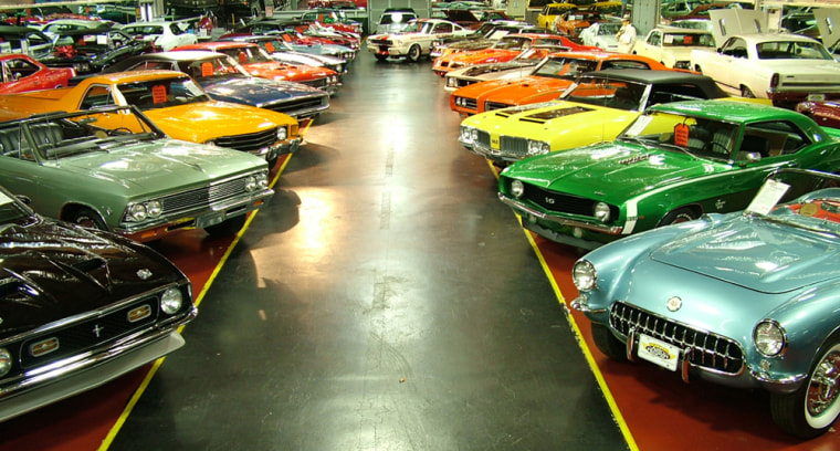 Classic cars are shown on display in the showroom at the