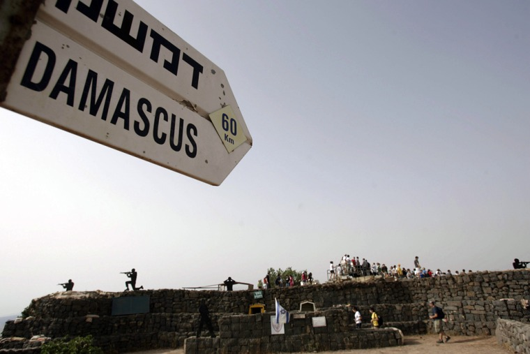 A sign showing the distance from an army post from the 1967 war at Mt. Bental in the Golan Heights to Damascus in June 6, 2007, photo.