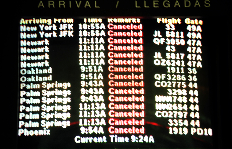 An arrival board at the Los Angeles Airport 11 Sep
