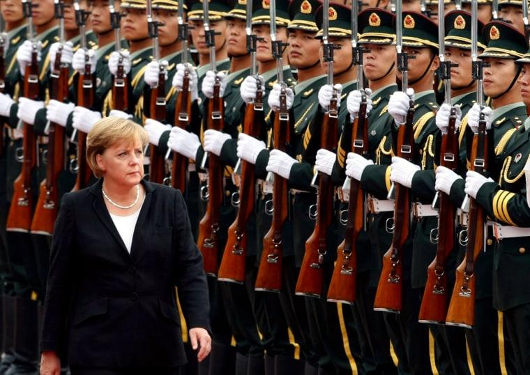 German Chancellor Angela Merkel inspects a guard of honour in Beijing
