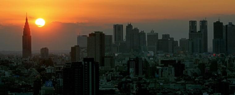 The sun sets behind Tokyo's Shijuku skys