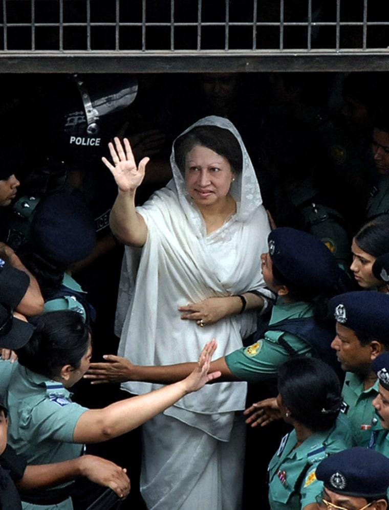 Former Bangladeshi Prime Minister Khaleda Zia leaves court Mondayfollowing her arrest in Dhaka.