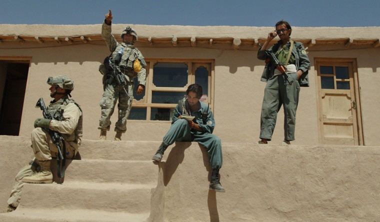 Afghan and US forces search houses