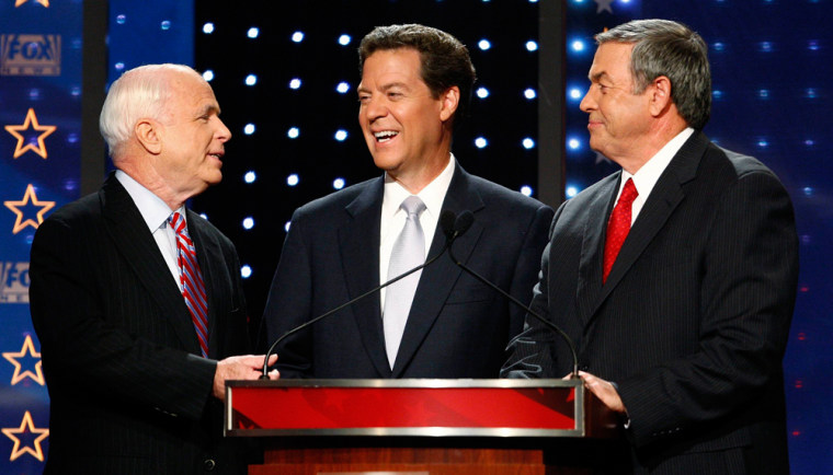 Republican presidential candidates take the stage for a debate at the University of New Hampshire in Durham