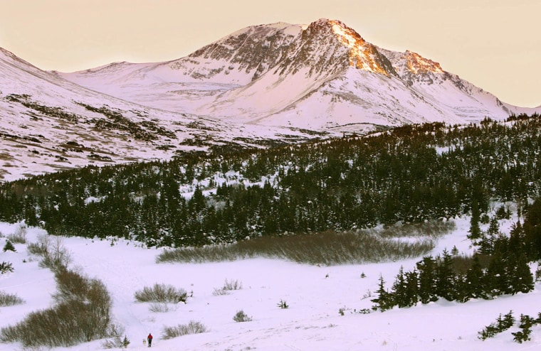 GAO investigators have concluded that earlier snowmelts,shown near Flat Top Mountain in Anchorage, Alaska,are being caused more by climate conditions than land management techniques.