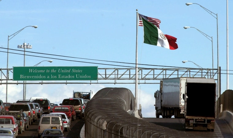 Mexican trucks drive on an international bridge leading to Texas. A pilot program would allow vehicles from 100 Mexican companies to travel beyond the current restrictions of around 20 miles inside the U.S.