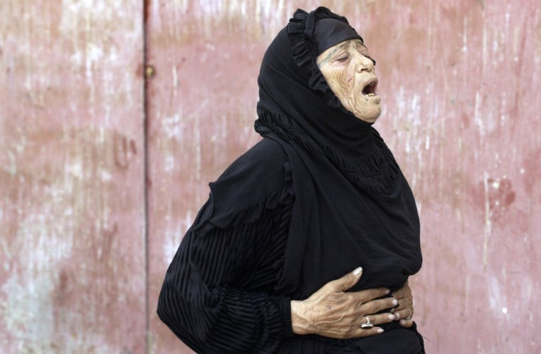 An Iraqi woman on Friday grieves for a relative in the Shiite holy city of Najaf, Iraq.