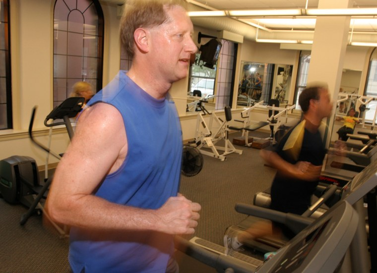 Tom Johnson runs on a treadmill at the Western & Southern Financial Group headquarters buildingin Cincinnati. The company is encouraging employees to reduce their health risks as insurance costs climb.
