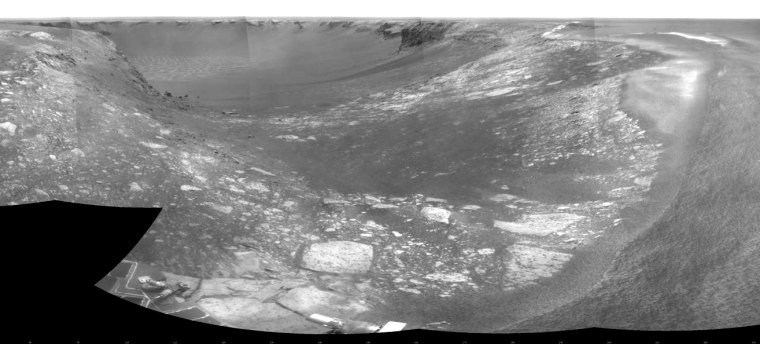 A wide-angle mosaic, assembled from images captured Aug. 28, shows Opportunity's surroundings as it operates on the lip of Victoria Crater. The crater looms in the background.Objects in the foreground are seen with an exaggerated perspective because of the way the images were put together.