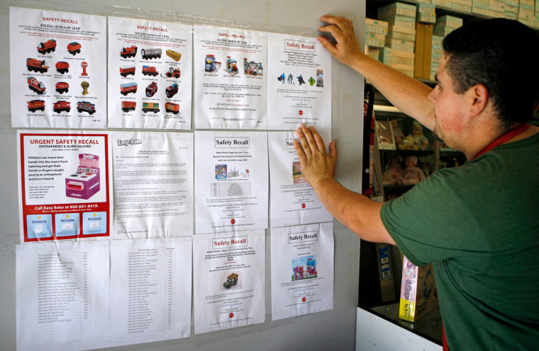 Mike Listerman, a retail clerk at Tom's Toys, posts safety recall bulletins at the neighborhood toy store in Montrose, Calif.