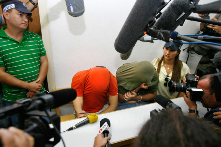 Israelis suspected of belonging to a neo-Nazi cell sit in court in Ramle