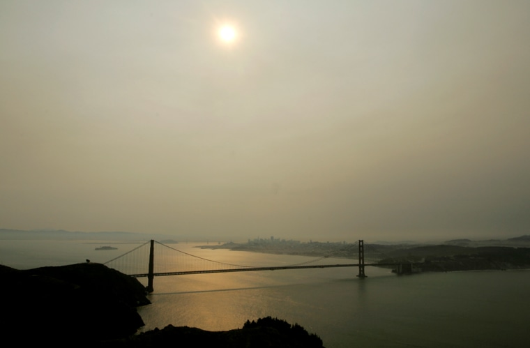 Smoke from a forest fire burning 200 miles away casts a haze over the Golden Gate Bridge and the San Francisco skyline last Thursday. The haze had lifted by Friday but was back on Sunday due to winds.
