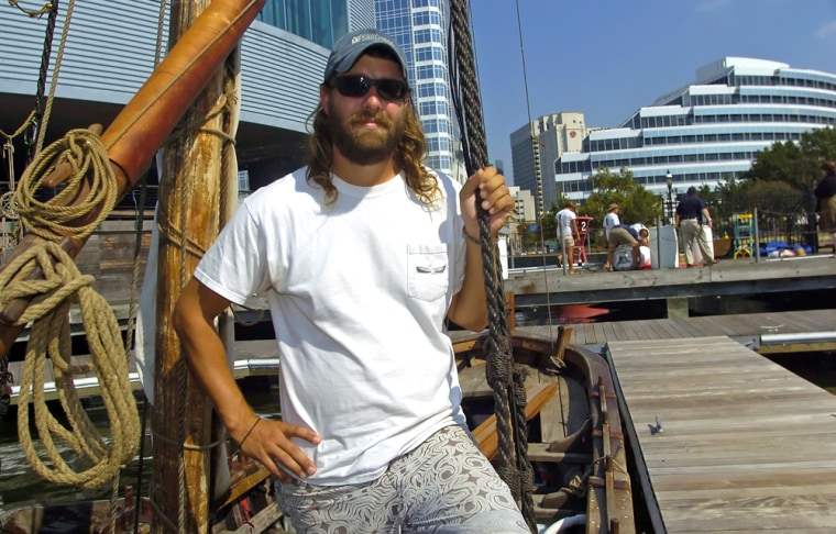 Ian Bystrom from Saint Simons Island, Ga., the captain of a replica of John Smith's shallop, stands aboard the boat in downtown Norfolk, Va., on Sept.4.