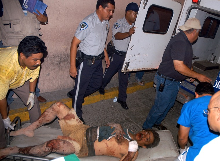 Rescuers helpa man who was injured on Monday in Mexicoafter a