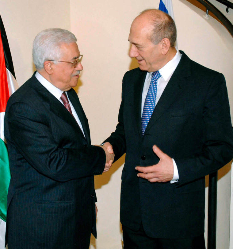 Israel's Prime Minister Olmert shakes hands with Palestinian President Abbas during meeting in Jerusalem