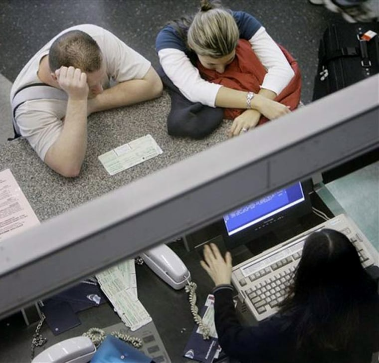 It pays to know your rights, and to be a little sneaky, when you're bumped from your flight involuntarily. To prevent being bumped, it also pays to get to the airport early. In this photo, passengers look for a new flight at Chicago's O'Hare International Airport.
