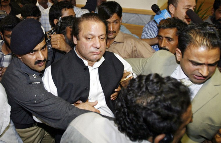 Former Pakistani prime minister Nawaz Sharif is arrested upon his arrival at Islamabad's airport