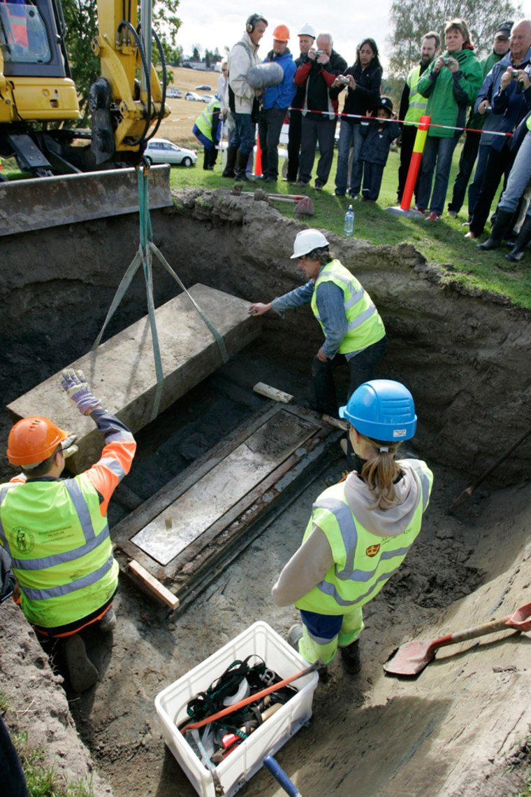 Archaeologists exhume the body of a Viking queen at the Oseberg mound in Norway