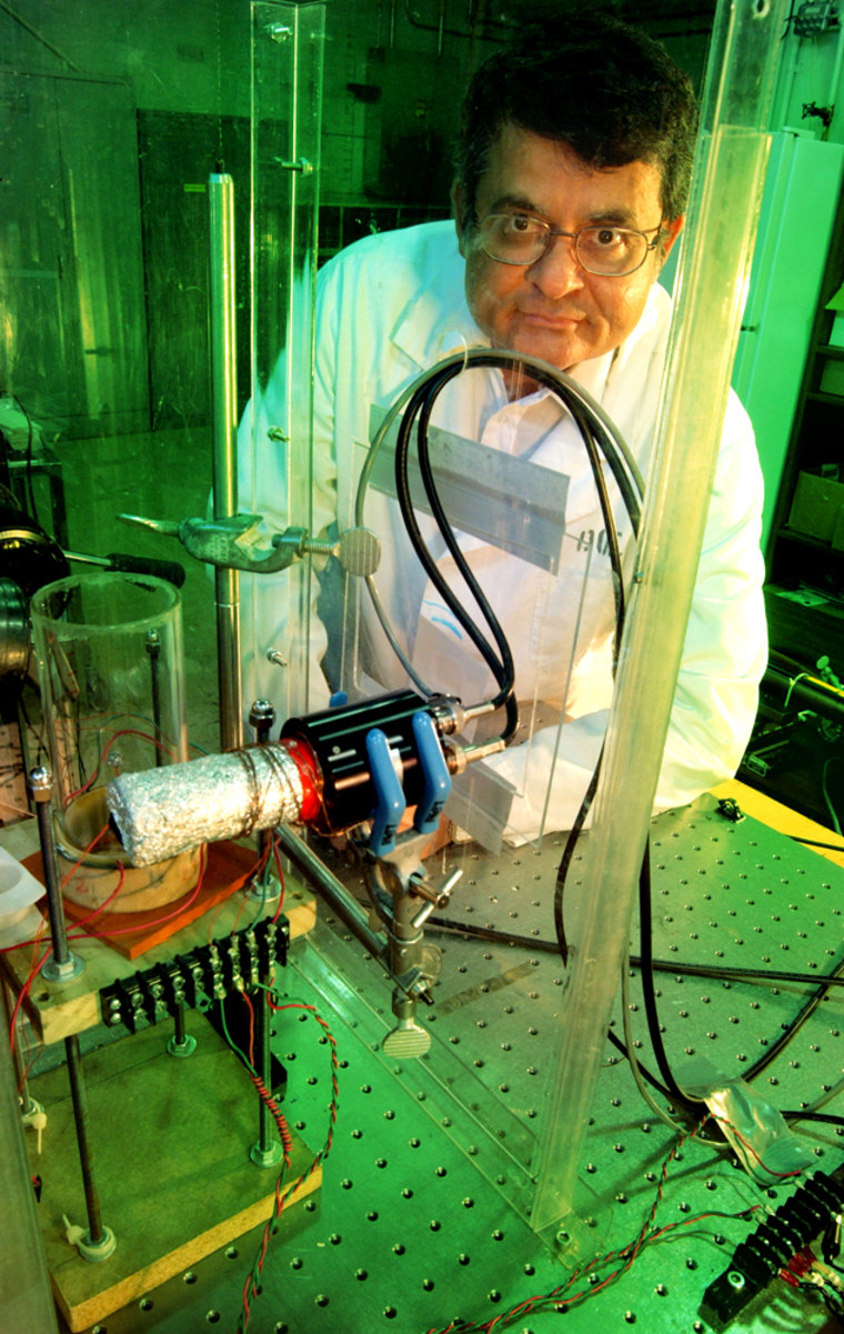 Purdue professor Rusi Taleyarkhan is shown here with a tabletop-fusion experiment in a U.S. Department of Energy facility in Oak Ridge, Tenn.