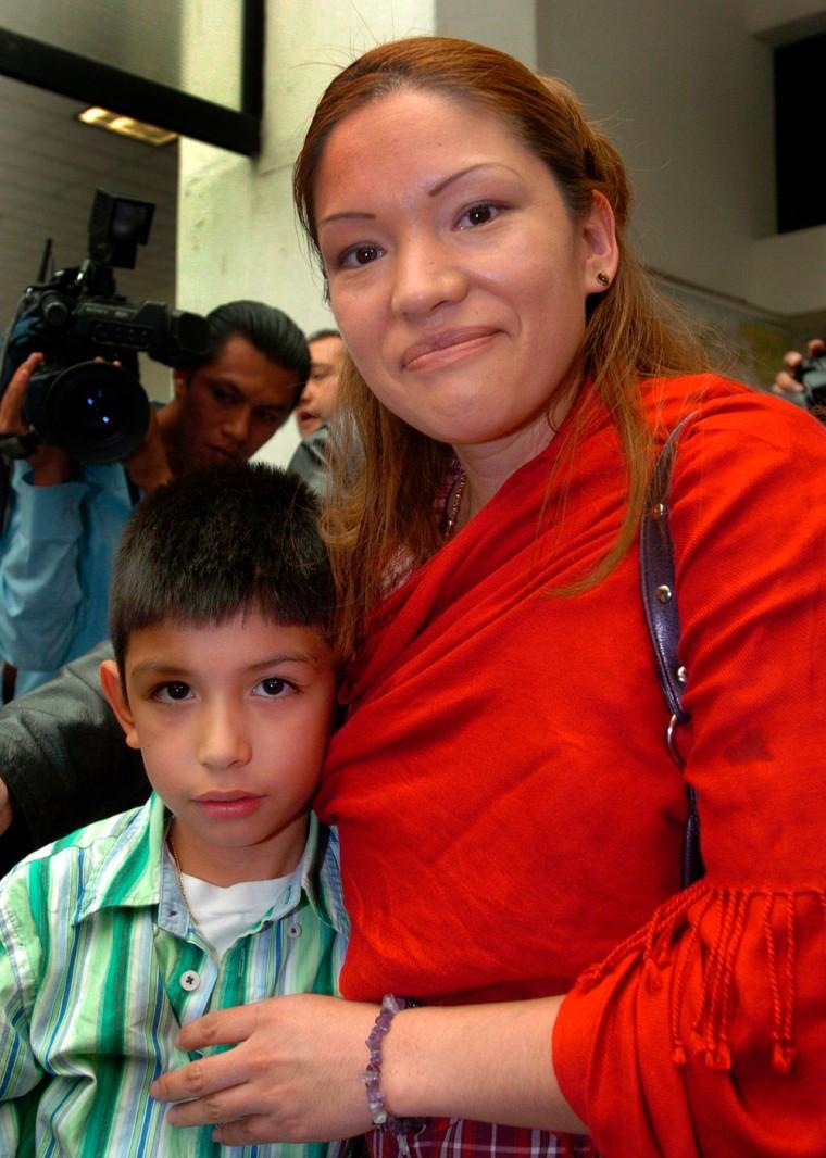 Saul Arellano embraces his mother Elvira Arellano