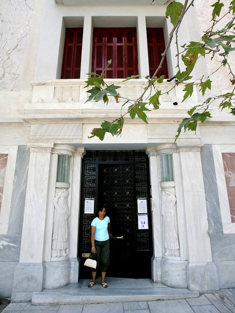 The entrance of 1930 Art Deco building at No. 17 Dionyssiou Areopagitou Street, built by Vassilis Kouremenos, a graduate of Paris' Ecole des Beaux Arts is seen in Athens earlier this summer.
