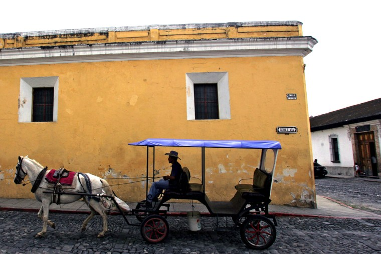A tourist carriage rides along a street in Antigua, 40 kilometers west of Guatemala City, earlier this month.