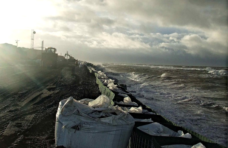 Sandbagshave been added in front of the seawall at Kivalina, Alaska, in this photo from Thursday.