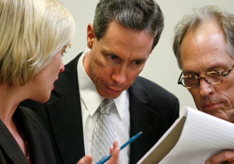 U.S. polygamist sect leader Warren Jeffs is flanked by his attorneys Isaacson and Wright at the end of the first day of Jeffs' trial  in St. George, Utah