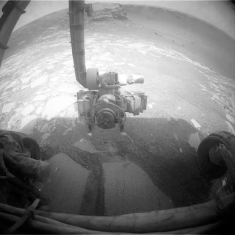 After finishing an in-and-out maneuver to check wheel slippage near the rim of Victoria Crater, NASA's Oppportunity rover re-entered the crater. This view shows the rover's instrument-laden robotic arm, with the crater in the background.