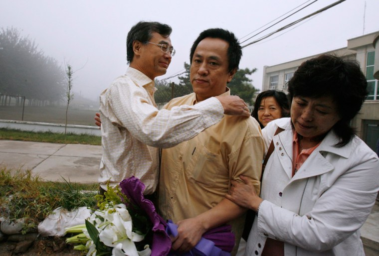 Zhao Yan is greeted by friends and relatives after release from prison in Beijing