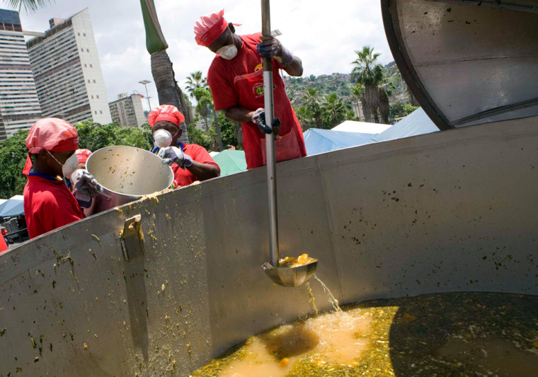 Cooks make a huge 'sancocho' - a traditional stew of beef, chicken, vegetables and potatoes - in a 15,000 liter pot in Caracas