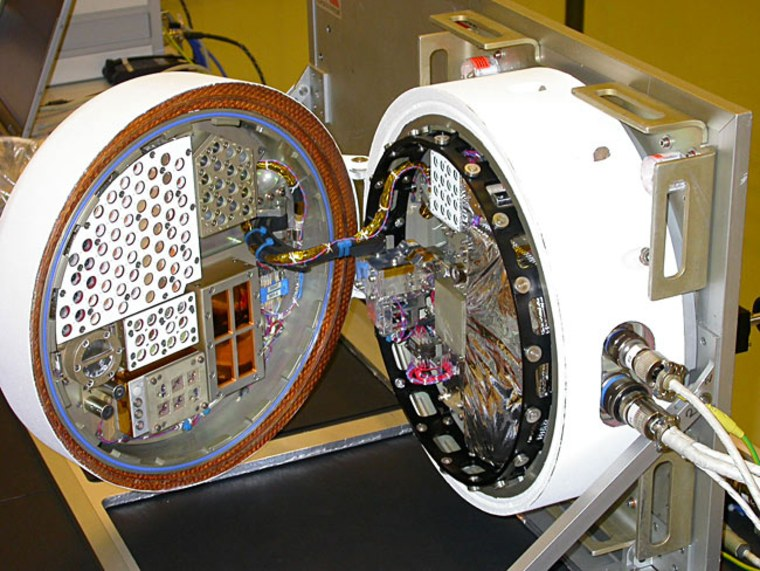 """The BIOPAN compartment, shown here, is designed to carry out experiments requiring direct exposure to the harsh environment of space. The European Space Agency's """"Life Marker Chip"""" is one of 10 different experiments that will test biological experiments in space."""