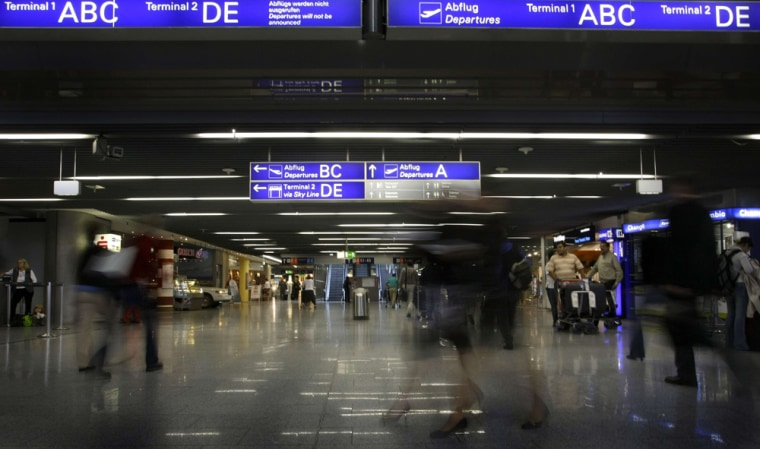 Passengers rush for connecting flights inside terminal one of Frankfurt's airport