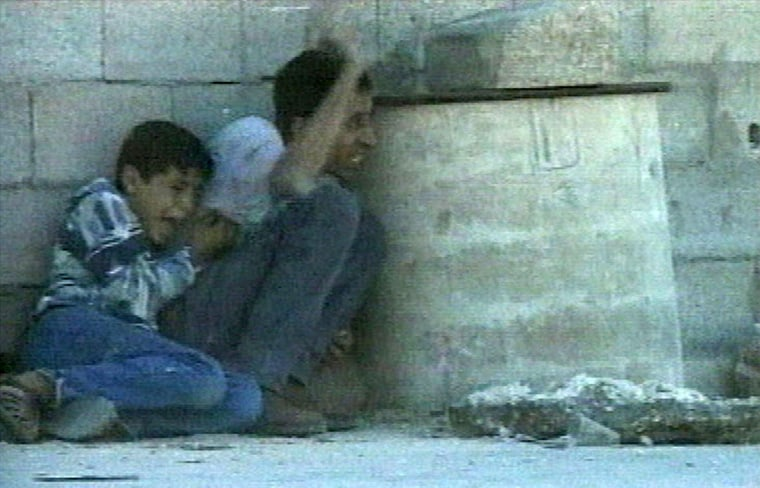 Footage captured on Sept. 30, 2000, depicted the death of Mohammed al-Dura, left. The images showed the terrified boy and his father, Jamal, cowering in front of a wall amid a furious exchange of fire between Israeli forces and Palestinian militants in the Gaza Strip.