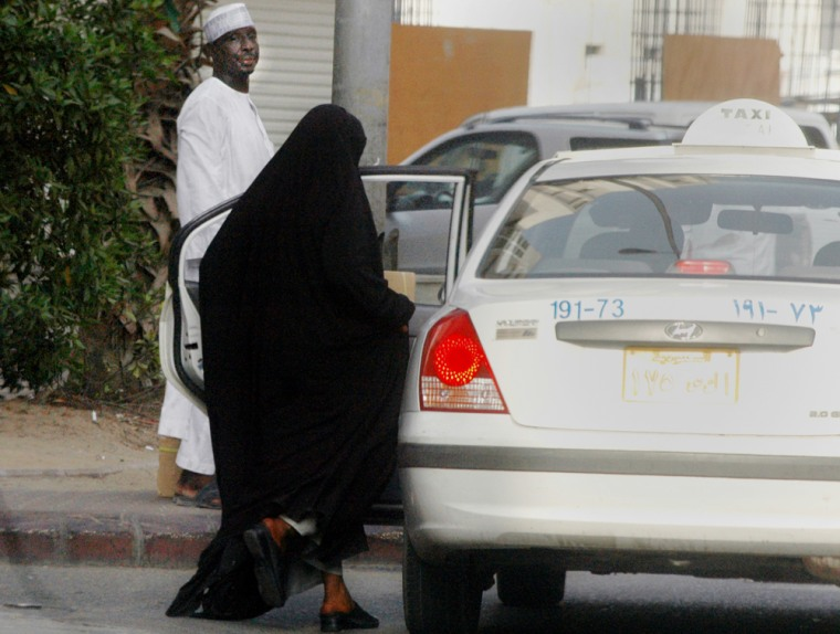A woman gets ina taxi in Jiddah, Saudi Arabia, on Monday. The driving ban applies to all women, Saudi and foreign, and forces families to hire live-in drivers.