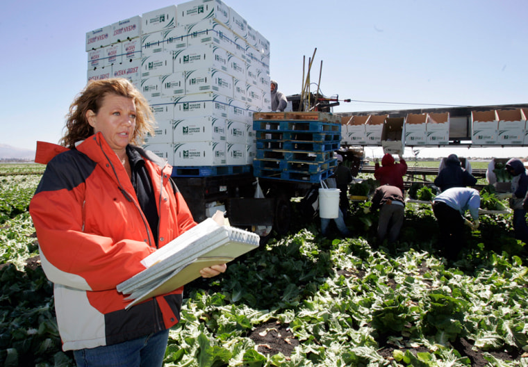 Roxann Bramlage, an auditor with the California Department of Food and Agriculture, monitors food safety conditions during harvesting of romaine lettuce in Salinas, Calif. On Monday, Dole recalled its bagged salads after a sample test in Canada was found to contain E. coli.