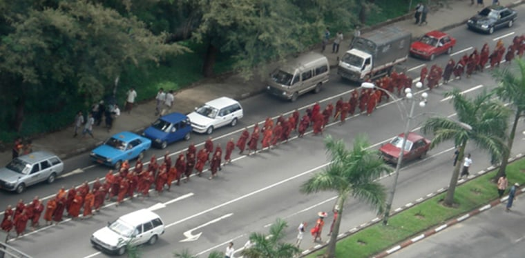 Buddhist monks march whilst chanting prayers and holy scriptures in Yangon