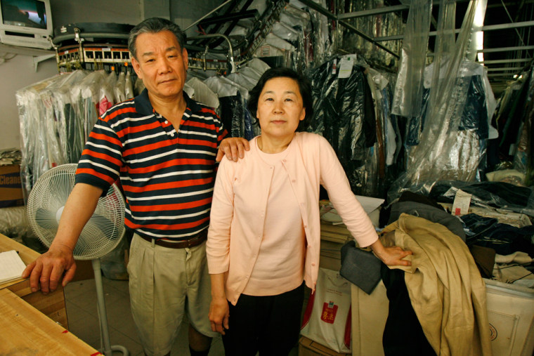 Jin Nam Chung, left, and Soo Chung stand in May inside their former dry cleaning business, Custom Cleaners, which theysold, their attorney said Wednesday.
