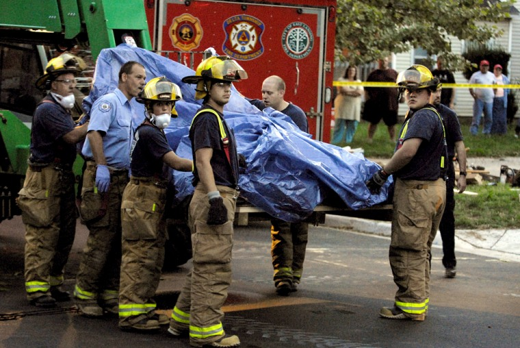 Michigan firefighters and paramedics removed a 900-pound manfrom the upper floor of a homeTuesday night.