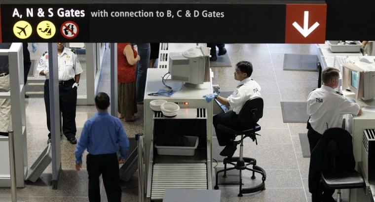 TSA workers screen passengers at Seattle-Tacoma International Airport in Seattle, Thursday, May 31, 2007.