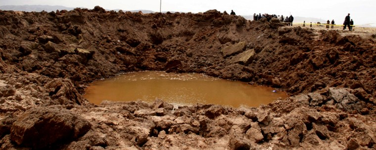 A crater is seen in Carangas, Puno, Peru, Monday, Sept. 17, 2007, caused by a supposed meteorite that crashed in southern Peru over the weekend.