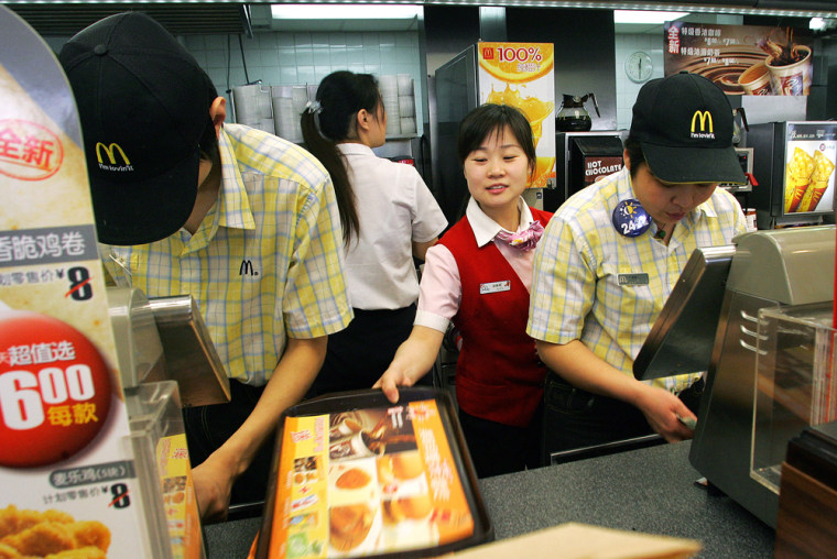 Chinese workers go about their business