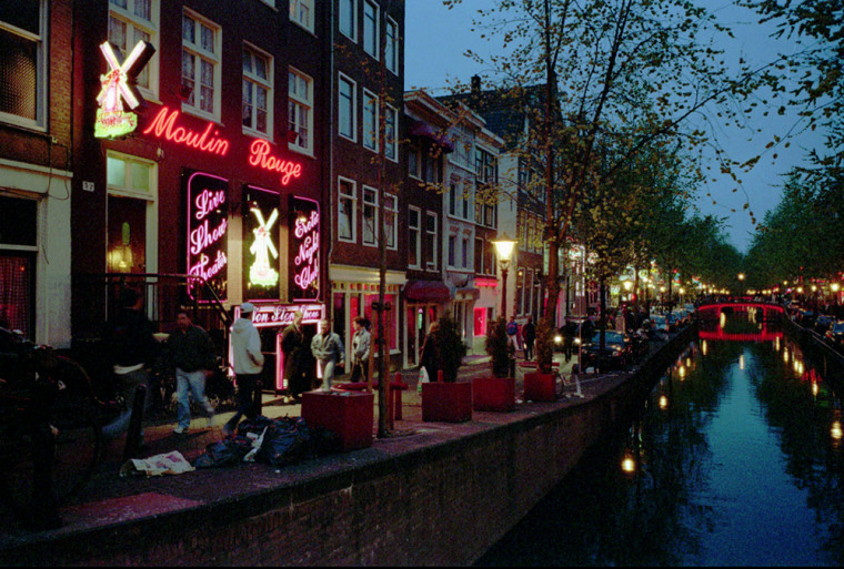 Anon-profit corporation in Amsterdam has purchased a large number of Red Light District buildings whereprostitutesposed in windows.