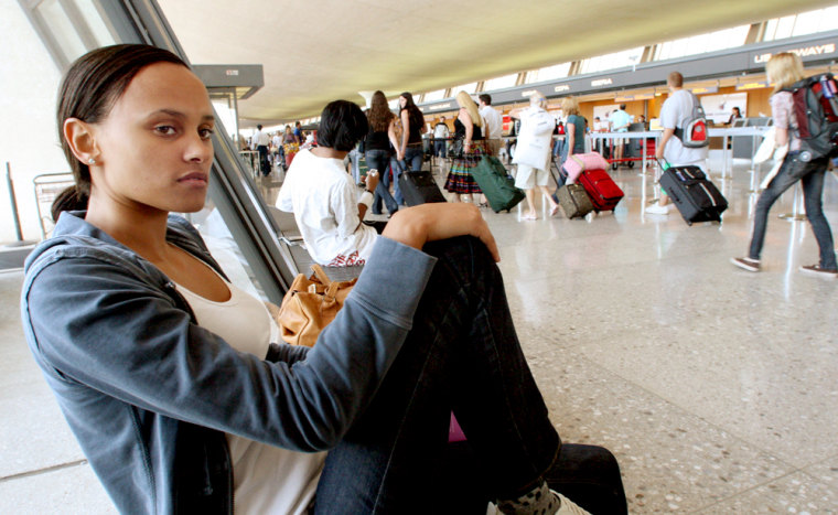 Christina Wright-Lyons, from London, waits in the main terminal at Dulles Airport for another flight to Heathrow, after a two-day delay in New York. A new U.S. aviation bill approved by the House of Representatives demands U.S. airlines and airports come up with plans to provide passengers stranded by long delays with food, water and other basic amenities.