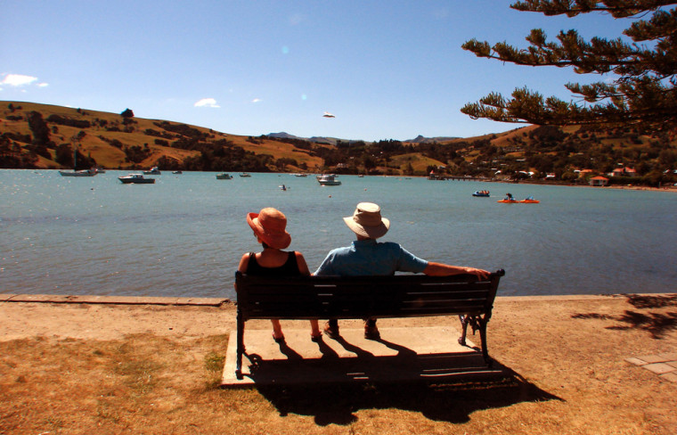 Vacationers enjoy the sunshine in the French-accented town of Akaroa, on the Banks Peninsula near Christchurch in New Zealand's South Island.