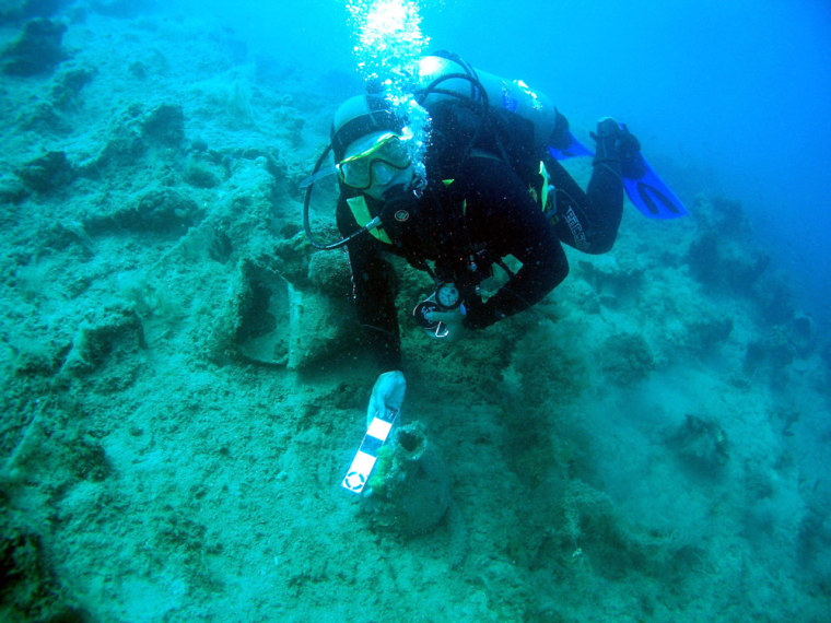This image released George Robb of the Key West, Fla.-based RPM Nautical Foundation measuring an amphora during a month-long survey, the first step in compiling an underwater cultural heritage map that could eventually plot the position of sunken fleets believed to lie along Albania's coastline.