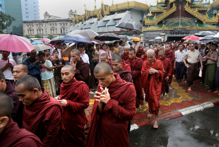Rain-drenched Buddhist monks march in Myanmar's largest city, Yangon, on Saturday.