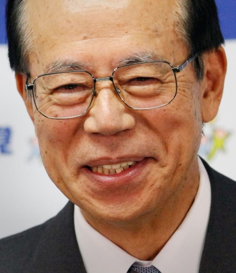 Former chief cabinet secretary Yasuo Fukuda smiles as he speaks at his first news conference after being elected president of the Liberal Democratic Party in Tokyo