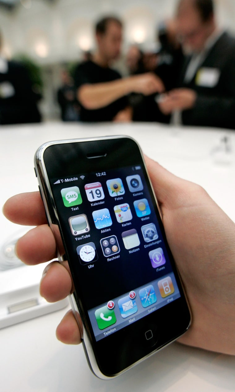 Journalists test an Apple iPhone following its introduction in Berlin