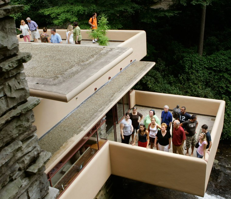 Visitors to Fallingwater, one of the architect Frank Lloyd Wright's best-known works, listen to tour guides as they stand on the terraces in Big Run, Pa. Another Wright creation, the Duncan House, has been moved from Lisle, Ill., to western Pennsylvania. Tours of the two impressive homes, Fallingwater and nearby Kentuck Knob, are available as well as the opportunity for an overnight stay in the 1950s-era Duncan House.